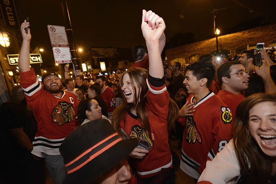 Chicago Blackhawks fans celebrate on Clark street in the Wrigleyville neighborhood after the Chicago Blackhawks won the Stanley Cup, defeating the Tampa Bay Lightning in Chicago on Monday, June 15, 2015. (AP Photo/Paul Beaty)