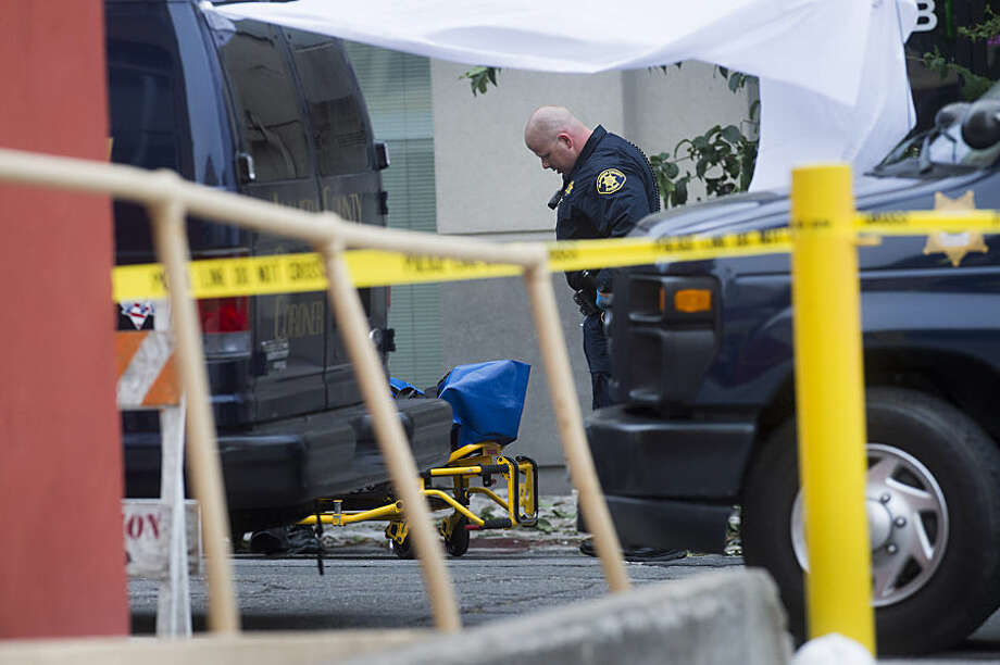 A sheriff's deputy prepares to move the body of a person who died when a fourth floor balcony collapsed in Berkeley, Calif. on Tuesday, June 16, 2015. Berkeley police say several people are dead and others are injured after the Library Gardens apartment balcony collapsed shortly before 1 a.m. near the University of California, Berkeley. (AP Photo/Noah Berger)