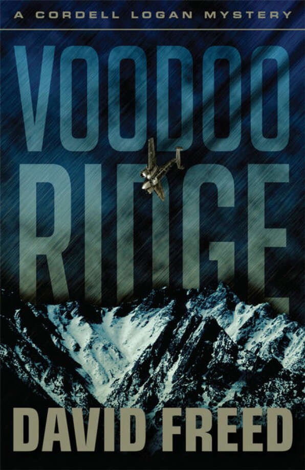 "This book cover image released by The Permanent Press shows ""Voodoo Ridge,"" by David Freed. (AP Photo/The Permanent Press)"