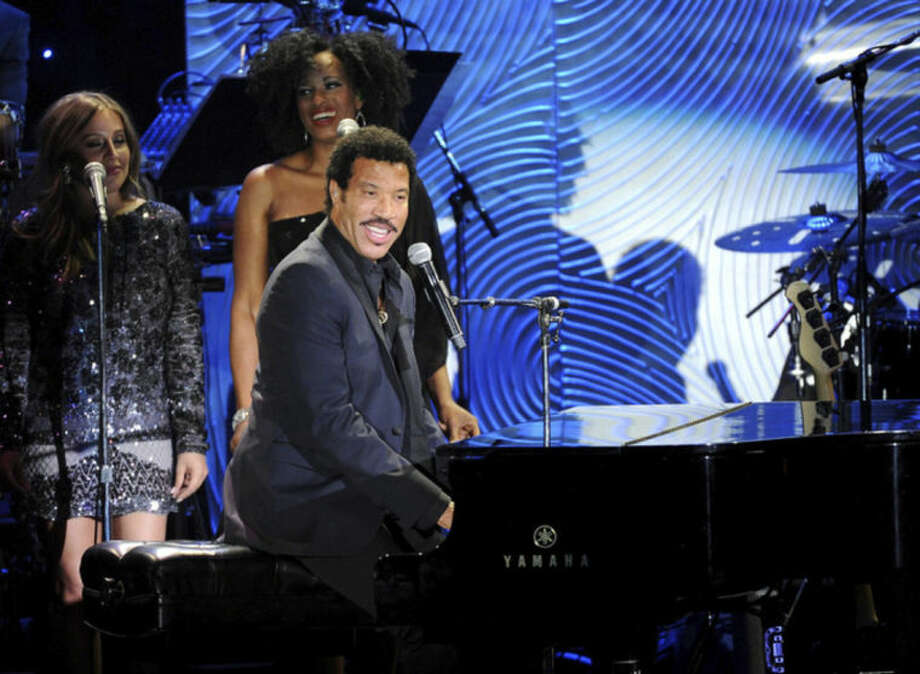 "FILE - In this Jan. 25, 2014 file photo, recording artist Lionel Richie performs onstage at The 56th Annual GRAMMY Awards Salute to Industry Icons with Clive Davis, at the Beverly Hilton Hotel in Beverly Hills, Calif. Richie continues last year's smash ""All The Hits All Night Long"" tour through summer 2014 in the U.S., making stops in some American cities he hasn't played in nearly a decade. (Photo by Frank Micelotta/Invision/AP, file)"