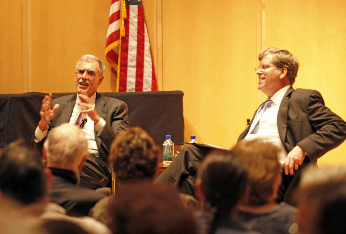Solicitor General Donald Verrilli speaks with President of the Board of Trustees, Michael Kaelin, at The Wilton Library Thursday evening.