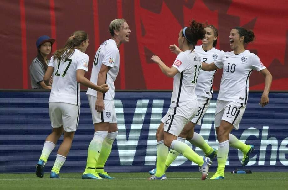 United States' Tobin Heath, fAbby Wambach, Lauren Holiday, Christie Rampone and Carli Lloyd, fromleft, celebrate Wambach's goal against Nigeria during the first half of a FIFA Women's World Cup soccer game Tuesday, June 16, 2105, in Vancouver, British Columbia, Canada. (Darryl Dyck/The Canadian Press via AP)