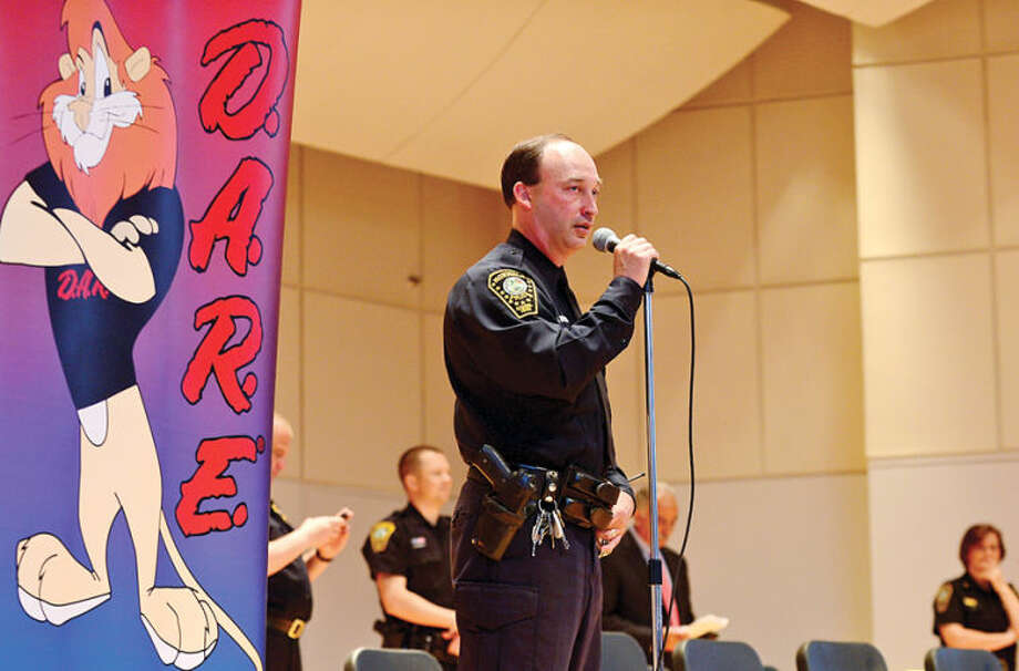 Hour photo / Erik Trautmann Officer Chris Holms addressses the students at The Norwalk Police Department DARE graduation for over a 1,000 Norwalk students Wednesday morning at City Hall.