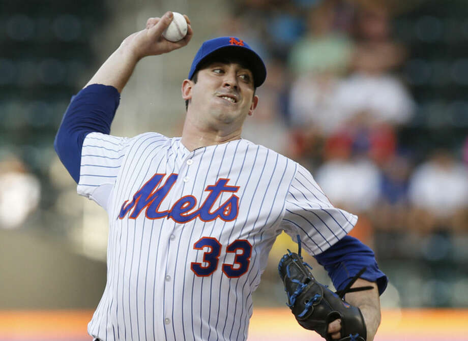 New York Mets starting pitcher Matt Harvey (33) delivers in the first inning of a baseball game against the Toronto Blue Jays in New York, Tuesday, June 16, 2015. (AP Photo/Kathy Willens)
