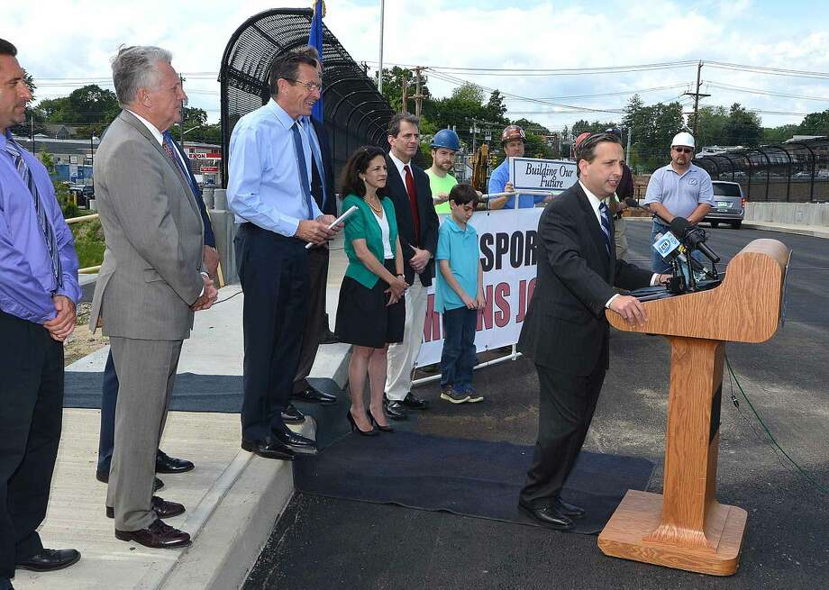 Hour Photo/Alex von Kleydorff State Senator Bob Duff talks about the progress of the ! 95 expansion project at exit 14 and 15 during a press conference on the Fairfield Ave overpass in Norwalk Wednesday