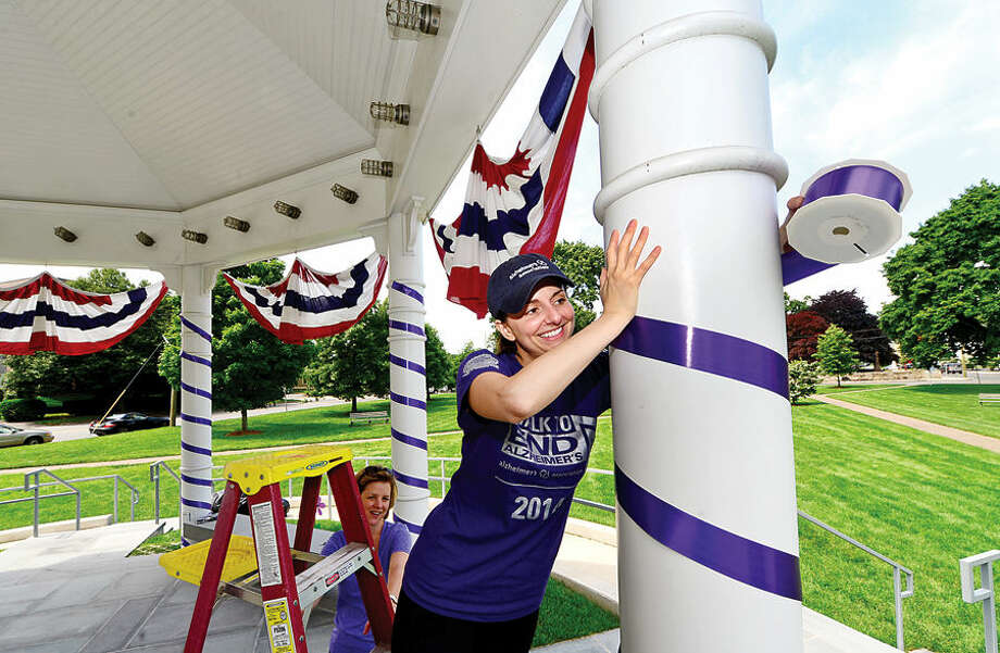 Hour photo / Erik Trautmann Lexi Rodriguez, Special Events Director, CT Chapter of the Alzheimer's Association, helps decorate the gazebo on the Norwalk Town Green in purple to raise Alzheimer's awareness.