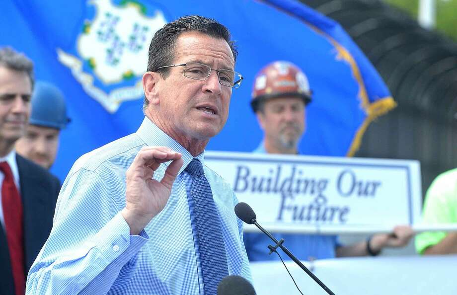 Hour Photo/Alex von KleydorffGov. Dan Malloy gives an update on the progress of the ! 95 expansion project at exit 14 and 15 during a press conference on the Fairfield Avenue overpass in Norwalk Wednesday.