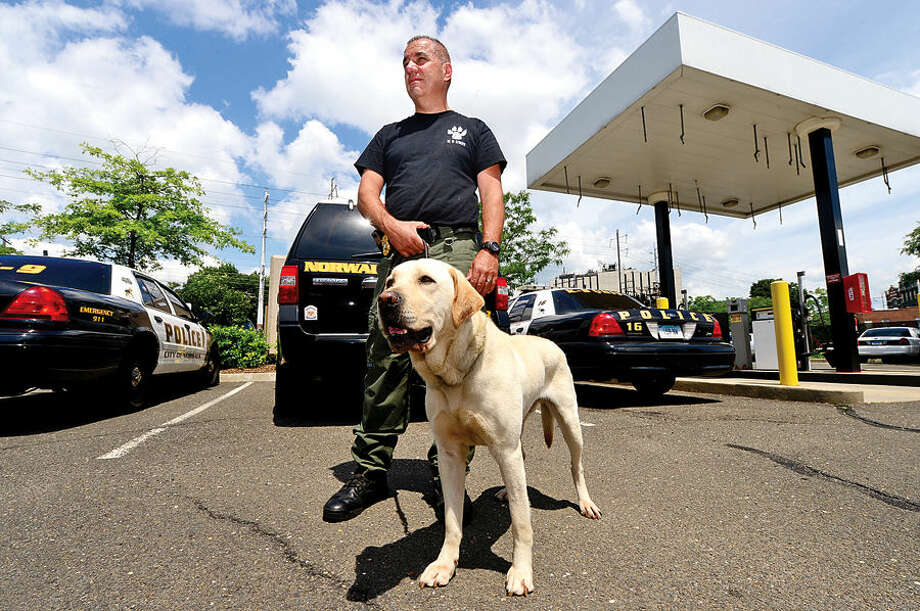 Hour photo / Erik TrautmannNorwalk police training Sgt. Frank Reda and his dog, Rocco.