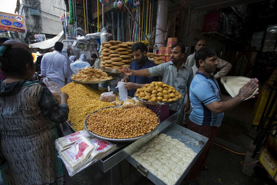 Pakistani customers buy foodstuff ahead of Ramadan in Rawalpindi, Peshawar, Pakistan, Tuesday, June 16, 2015. Muslims throughout the world mark the month of Ramadan, the holiest month in the Islamic calendar, with dawn to dusk fasting. (AP Photo/B.K. Bangash)