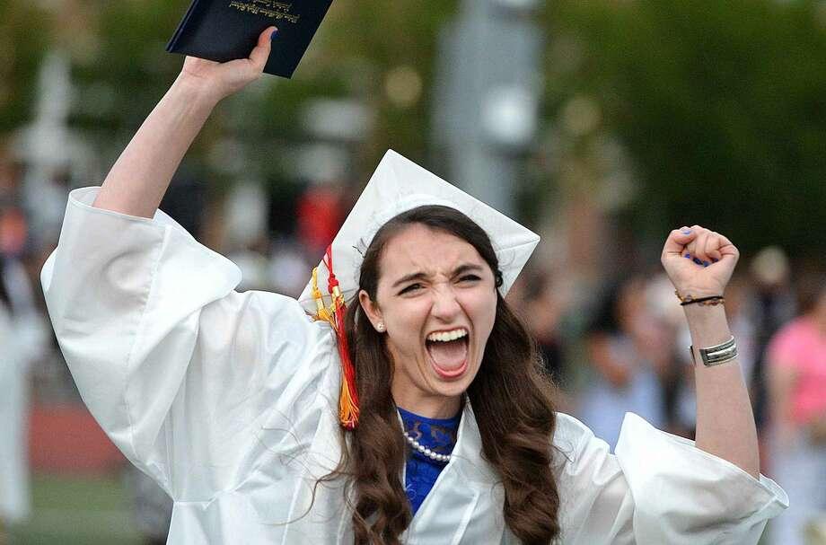 Hour Photo/Alex von Kleydorff Annie DeVita has diploma in hand with the class of 2015 during Brien McMahon High School graduation