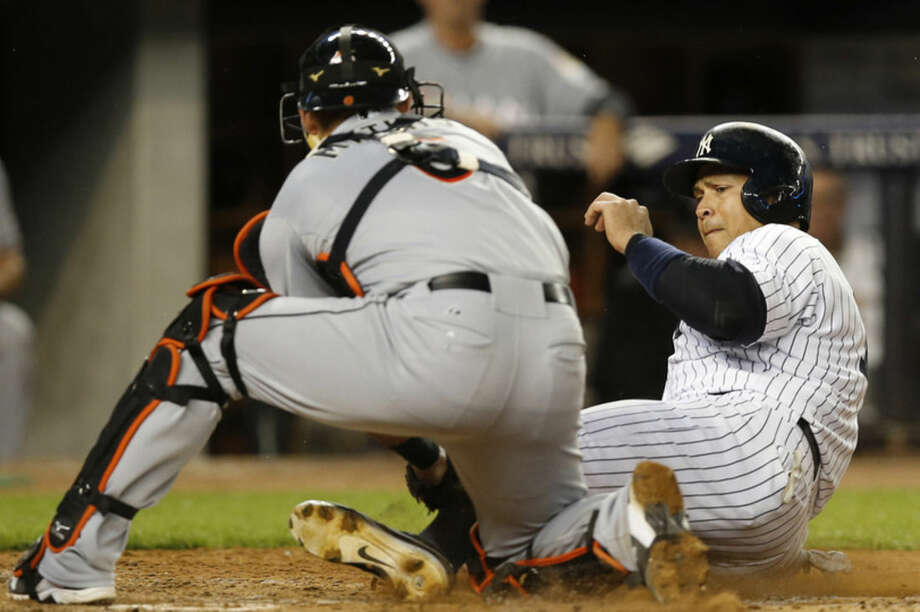 Miami Marlins catcher Jeff Mathis (6) tags out New York Yankees' Alex Rodriguez out at the plate during the fifth inning of a baseball game at Yankee Stadium in New York, Wednesday, June 17, 2015. (AP Photo/Kathy Willens)