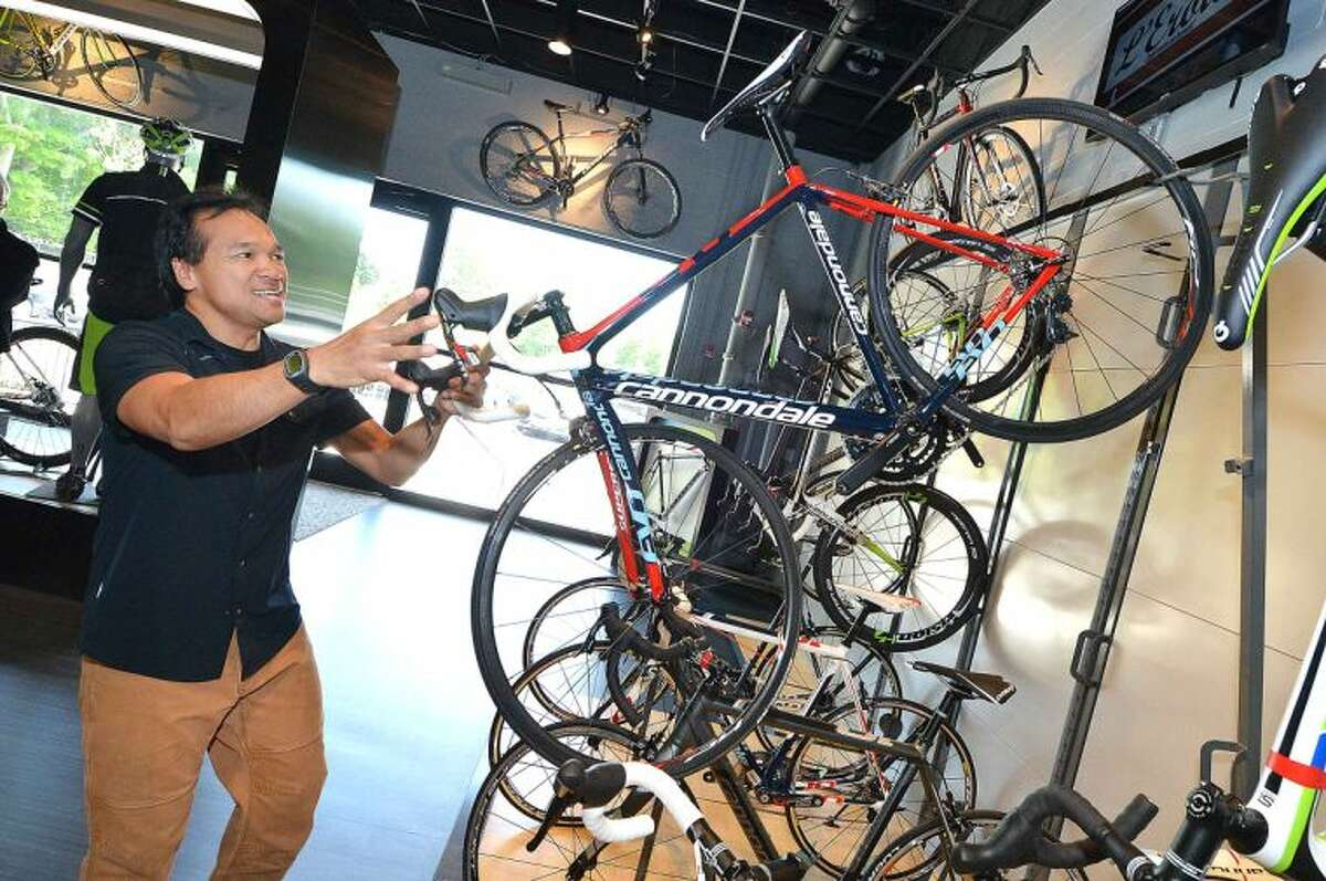 Hour Photo/Alex von Kleydorff Ed Mantaring, General Manager of the Carle Place LI. Retail store shows how bikes are stacked in the Cannondal Retail 'Lab' Showroom.