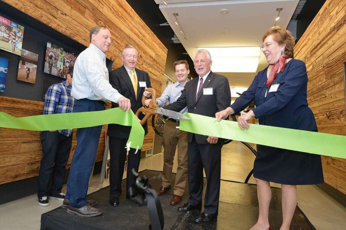 Hour Photo/Alex von Kleydorff Joe Cotter with National Rescources holds the ribbon as Wilton First selectman Bill Brennan cuts the ribbon, Cycling Sports Group President and CEO Peter Woods, Norwalk mayor Harry Rilling and National Rescources Lynn Ward during an open house to recognize May, as National Bike Month at Cannondale Headquaters in Wilton