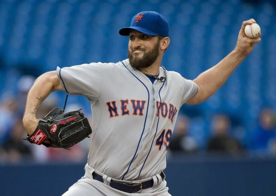 New York Mets starting pitcher Jon Niese works against the Toronto Blue Jays during first inning of a baseball game, Wednesday, June 17, 2015 in Toronto. (Nathan Denette/The Canadian Press via AP) MANDATORY CREDIT
