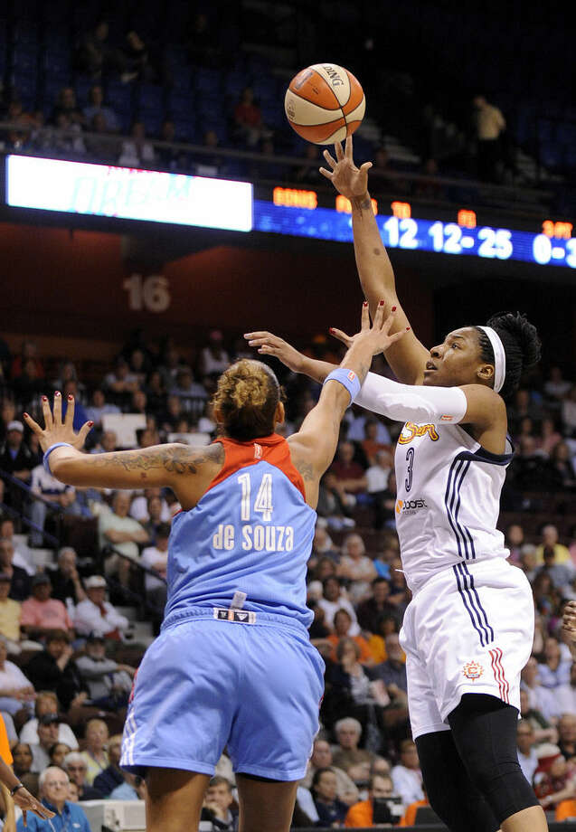 Connecticut Sun's Kelsey Bone (3) shoots over Atlanta Dream's Erika de Souza (14) during the first half of a WNBA basketball game in Uncasville, Conn., on Sunday, June 14, 2015. (AP Photo/Fred Beckham)