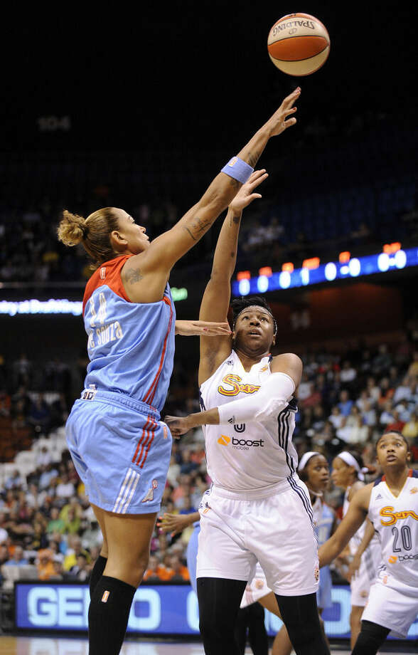 Atlanta Dream's Erika de Souza (14) shoots over Connecticut Sun's Kelsey Bone (3) during the first half of a WNBA basketball game in Uncasville, Conn., on Sunday, June 14, 2015. (AP Photo/Fred Beckham)