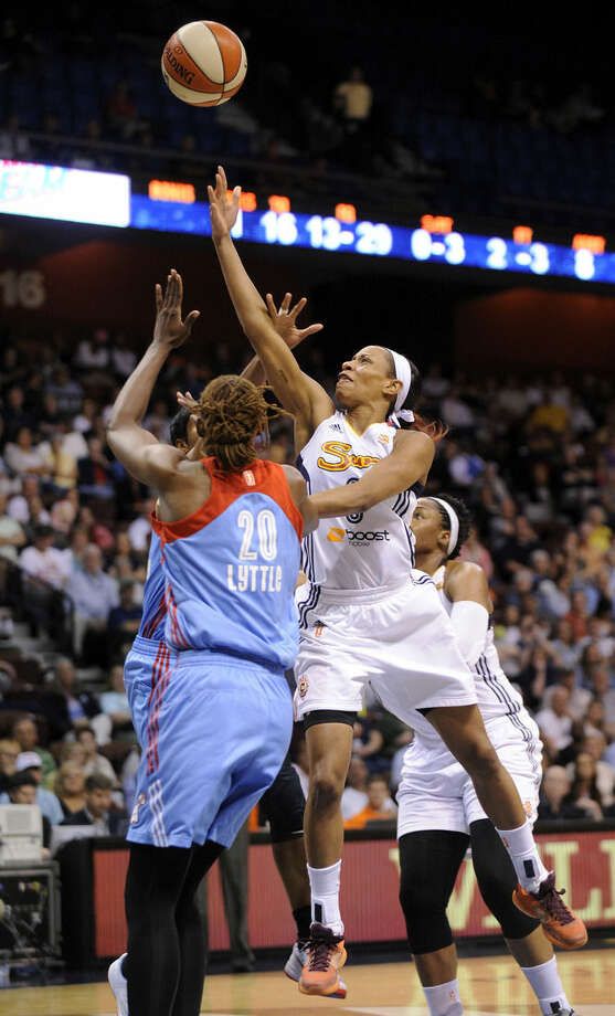 Connecticut Sun's Jasmine Thomas (6) shoots over Atlanta Dream's Sancho Lyttle (20) during the first half of a WNBA basketball game in Uncasville, Conn., on Sunday, June 14, 2015. (AP Photo/Fred Beckham)