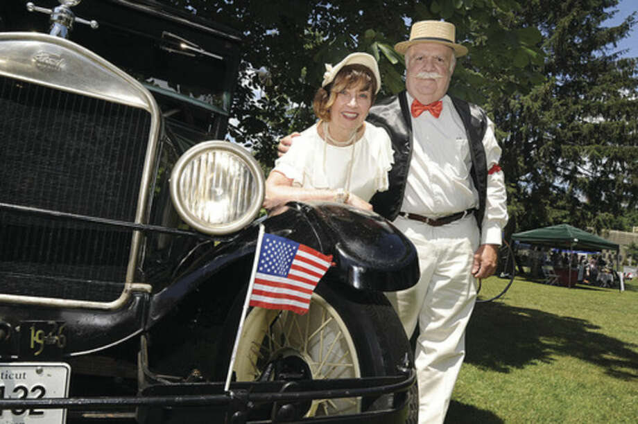Peggy and Don Morey dress in style with their 1926 Model T Sunday at the Ice Cream Social held at the park at Lockwood Mathews Mansion.