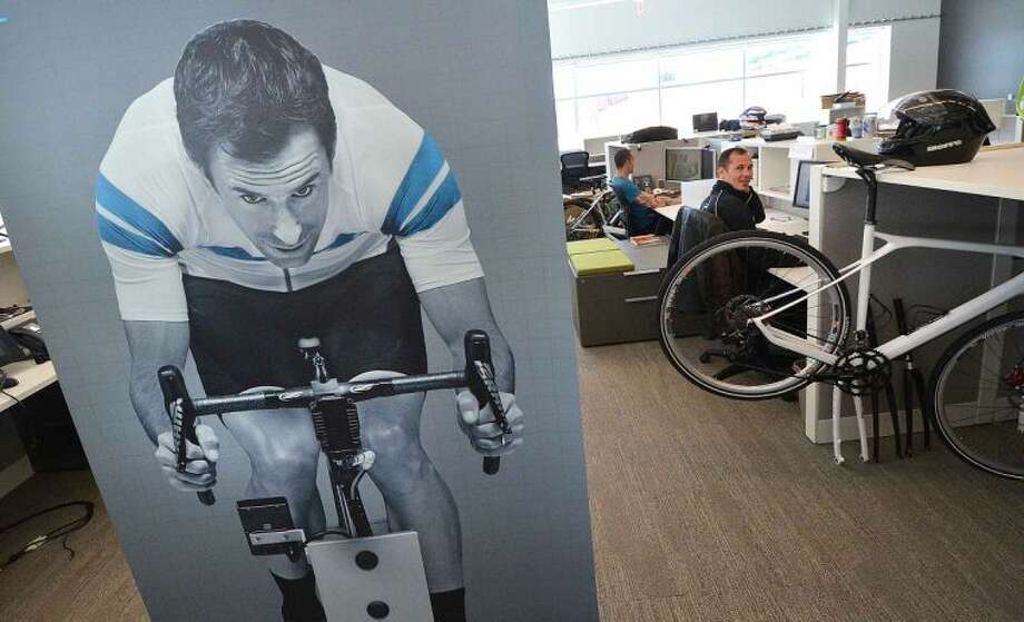 Hour Photo/Alex von Kleydorff Posters hang in the busy engineering department at Cannondale Sports Unlimited in Wilton