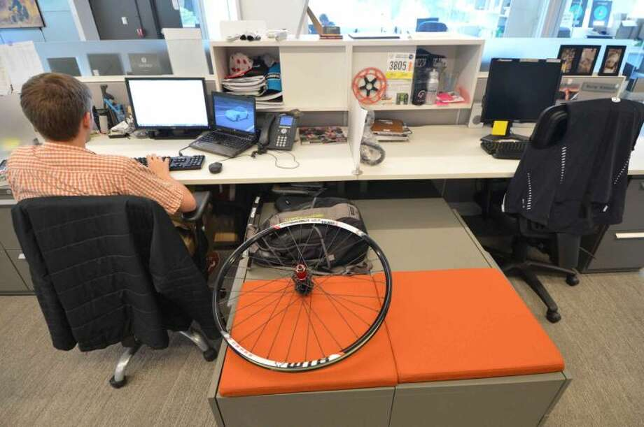 Hour Photo/Alex von Kleydorff David Devine, Global Senior Project manager for Road Bikes works on some graphics at Cannondale Global headquarters at I Park
