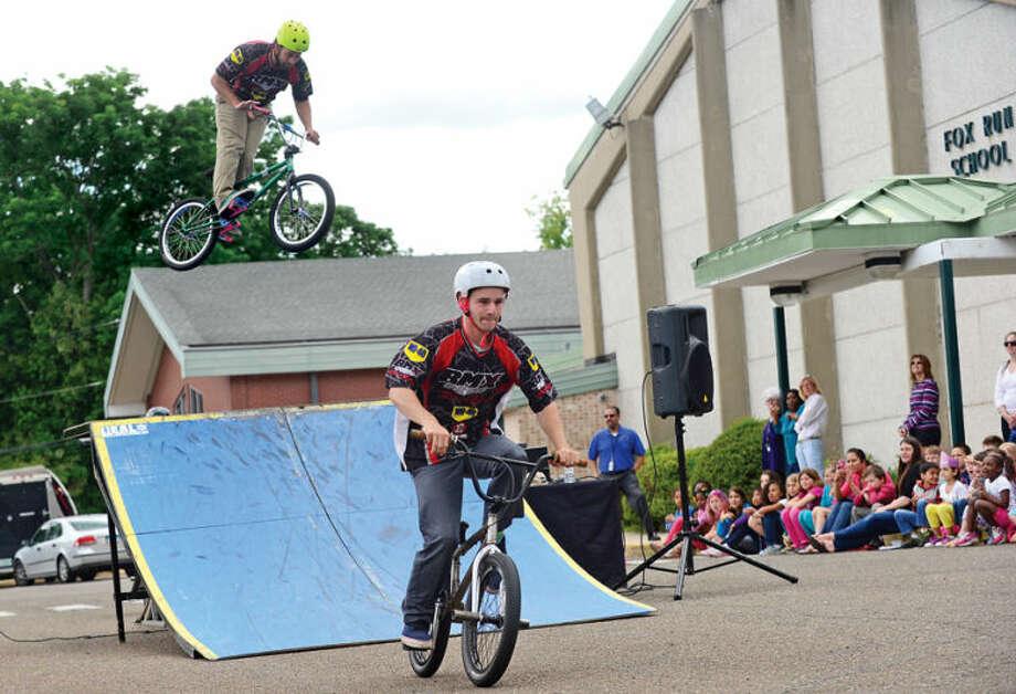 Hour photo / Erik Trautmann Fox Run Elementary School hosts the BMX troupe Perfection On Wheels Friday at the school.