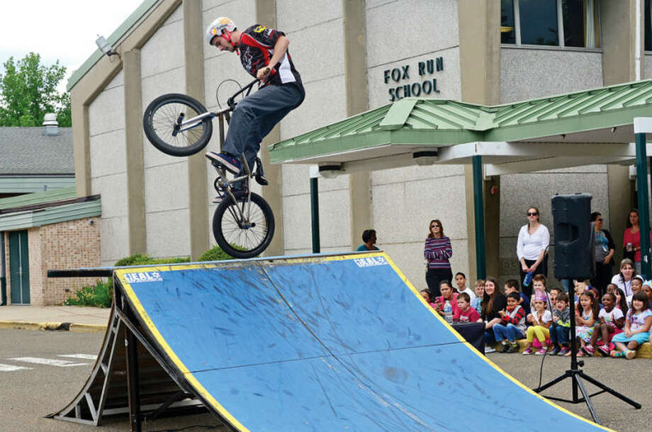 Hour photo / Erik Trautmann Fox Run Elementary School hosts the BMX troupe, Perfection On Wheels, Friday at the school.