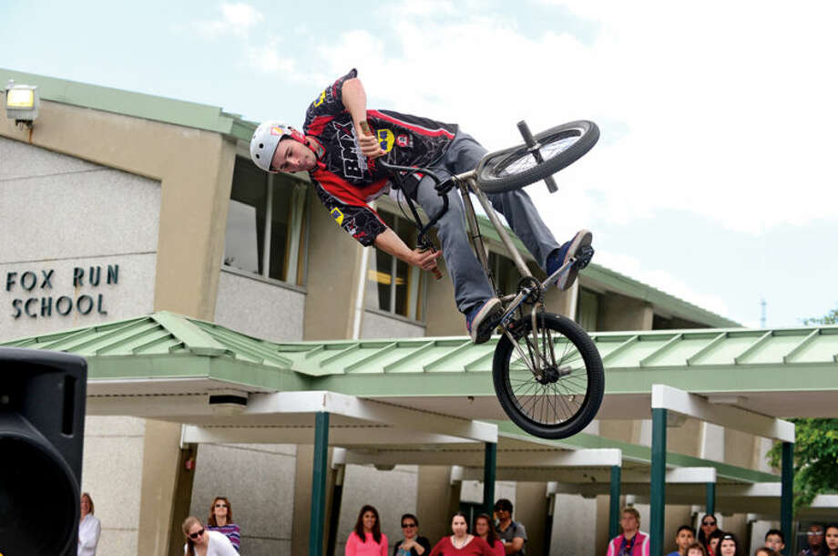 Hour photo / Erik Trautmann Fox Run Elementary School hosts Seth Bernard and the BMX troupe Perfection On Wheels Friday at the school.