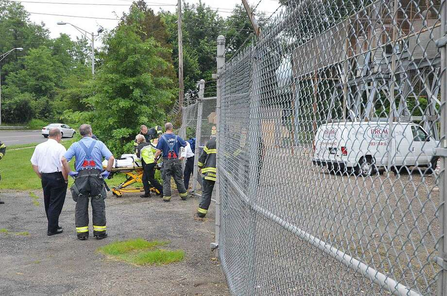 Hour Photo/Alex von Kleydorff Scene of the Ely Ave. Substation on Martin Luther King Blvd. where a commercial van left the road, went through the fence and was lodged inside the substation