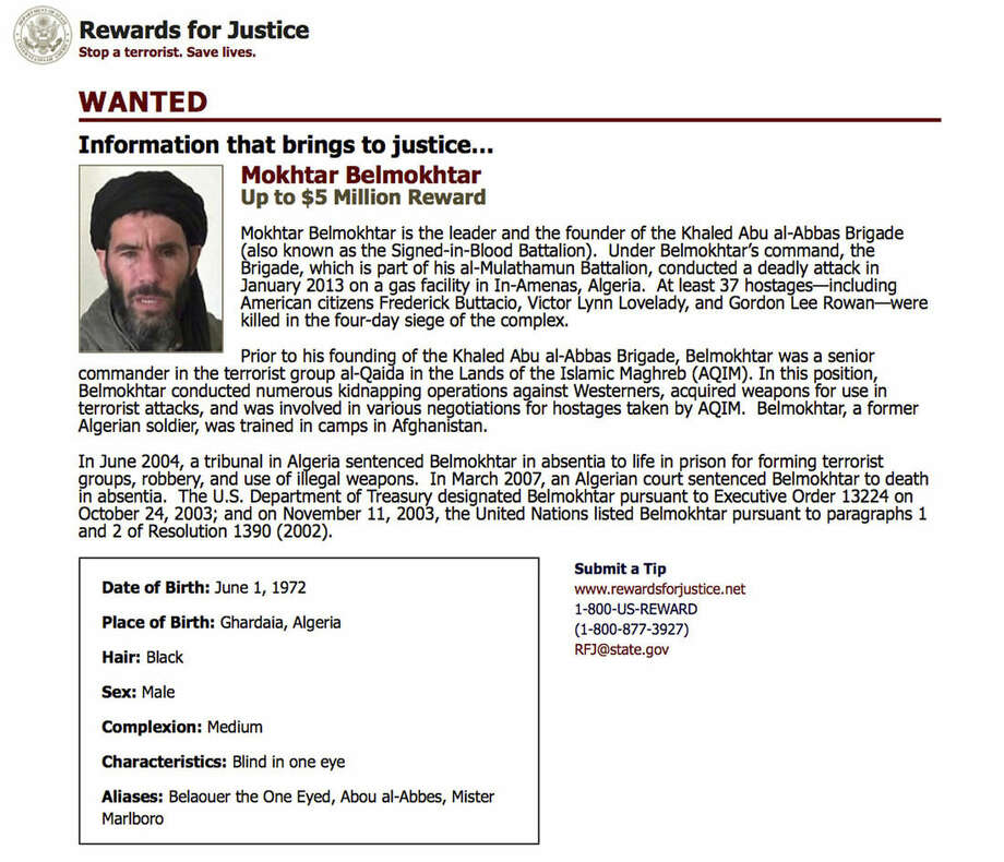 This wanted poster from the website of the U.S. State Department's Rewards For Justice program shows a mugshot of Mokhtar Belmokhtar, charged with leading the attack on a gas plant in Algeria in 2013 that killed at least 35 hostages, including three Americans. The U.S military said on Monday, June 15, 2015 it likely killed the al-Qaida-linked militant leader when it launched airstrikes in eastern Libya over the weekend. (U.S. State Department Rewards For Justice via AP)