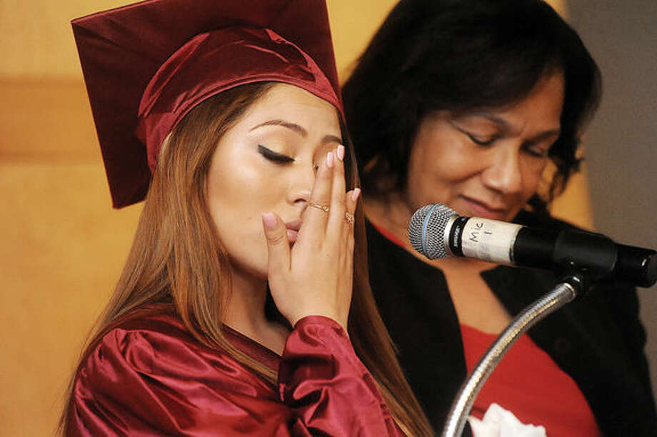 Student speaker Marcela Menjivar gets emotional Monday night with Principal Dr. Marie Allen by her side at the Briggs High School graduation held at the Brien McMahon Center for Global Studies. Hour photo/Matthew Vinci
