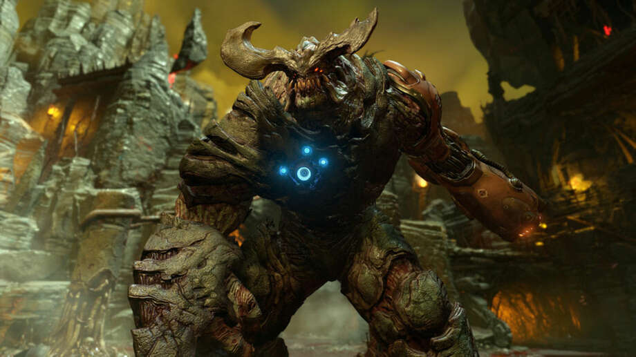 """This photo provided by Bethesda Softworks shows a screenshot with Cyberdemon from the video game, """"DOOM."""" (Bethesda Softworks via AP)"""