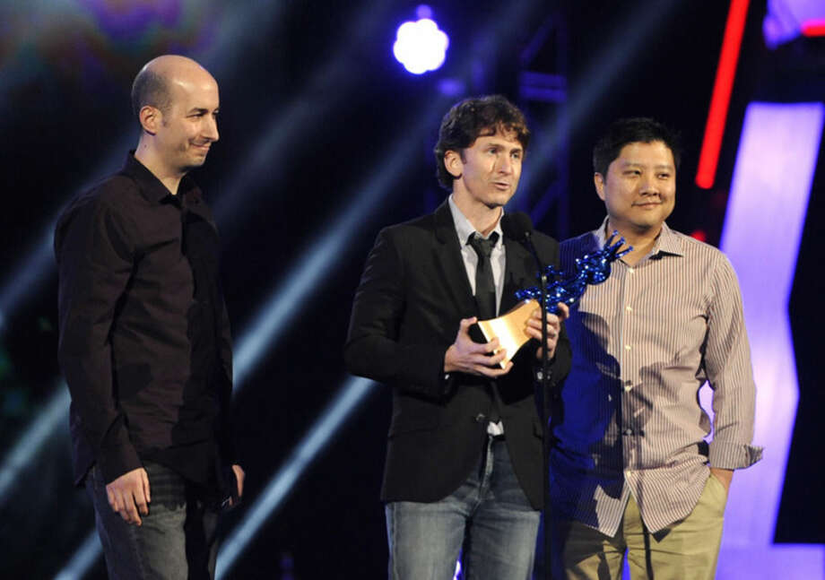 "FILE - In this Dec. 10, 2011 file photo, Todd Howard, center, of Bethesda Game Studios, is joined by members of his team as he accepts the award for game of the year for ""The Elder Scrolls V: Skyrim"" at Spike TV's Video Game Awards in Culver City, Calif. The publisher of the ""Doom,"" ""Fallout"" and ""Elder Scrolls"" video game series is kicking off this year's Electronic Entertainment Expo, held June 16-18, 2015, with their first-ever E3 press conference, in Los Angeles. (AP Photo/Chris Pizzello, File)"