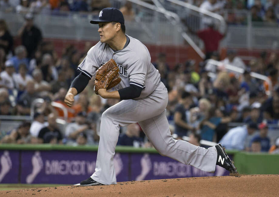 New York Yankees starting pitcher Masahiro Tanaka throws to the Miami Marlins during the first inning of a baseball game in Miami, Monday, June 15, 2015. (AP Photo/J Pat Carter)