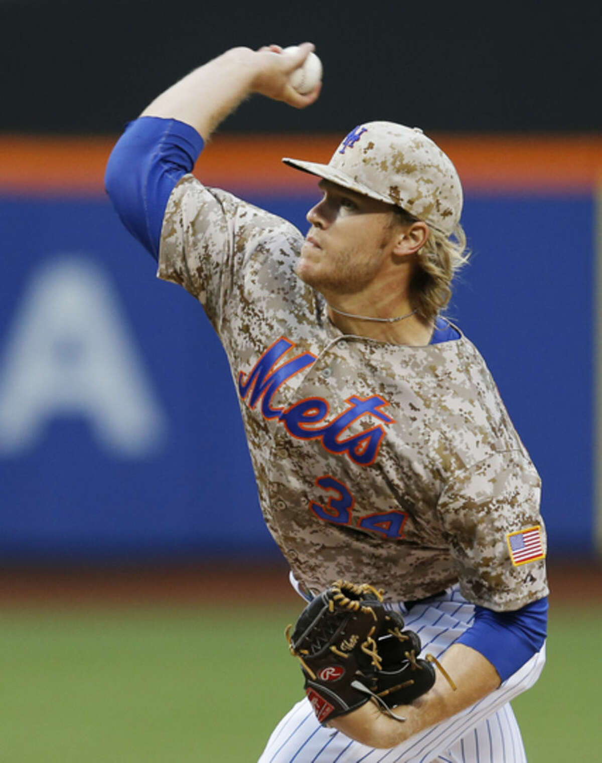 New York Mets starting pitcher Noah Syndergaard delivers in the first inning of a baseball game against the Toronto Blue Jays in New York, Monday, June 15, 2015. (AP Photo/Kathy Willens)