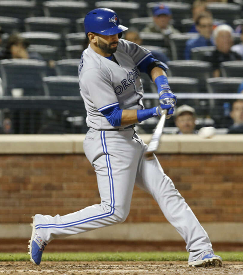 Toronto Blue Jays designated hitter Jose Bautista hits an ninth inning solo home run, his second, in a baseball game against the New York Mets in New York, Monday, June 15, 2015. (AP Photo/Kathy Willens)