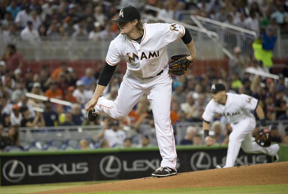 Miami Marlins starting pitcher Tom Koehler follows through on a delivery to the New York Yankees during the first inning of a baseball game in Miami, Monday, June 15, 2015. (AP Photo/J Pat Carter)