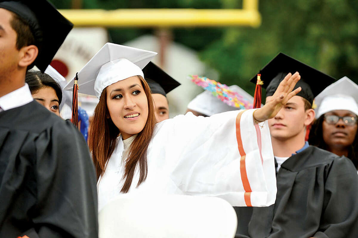 Hour photo / Erik Trautmann Stamford High School seniors celebrate during their commencement ceremonies for the Class of 2015 Thursday.