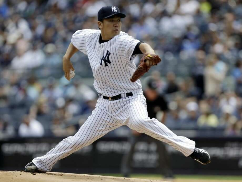 New York Yankees' Masahiro Tanaka, of Japan, delivers a pitch during the first inning of a baseball game against the Minnesota Twins Saturday, May 31, 2014, in New York. (AP Photo/Frank Franklin II)
