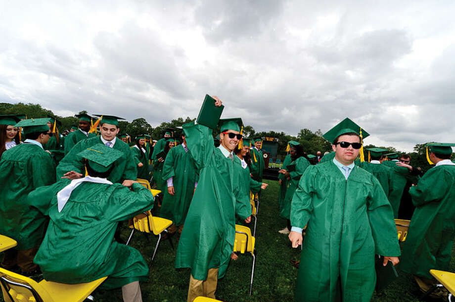 Hour photo / Erik Trautmann Trinity Catholic High School graduates the class of 2014.