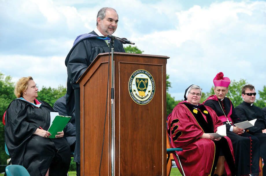 Hour photo / Erik Trautmann Tony Pavia gives his last graduation address as principal during the commencement excercises of the Trinity Catholic High School class of 2014.