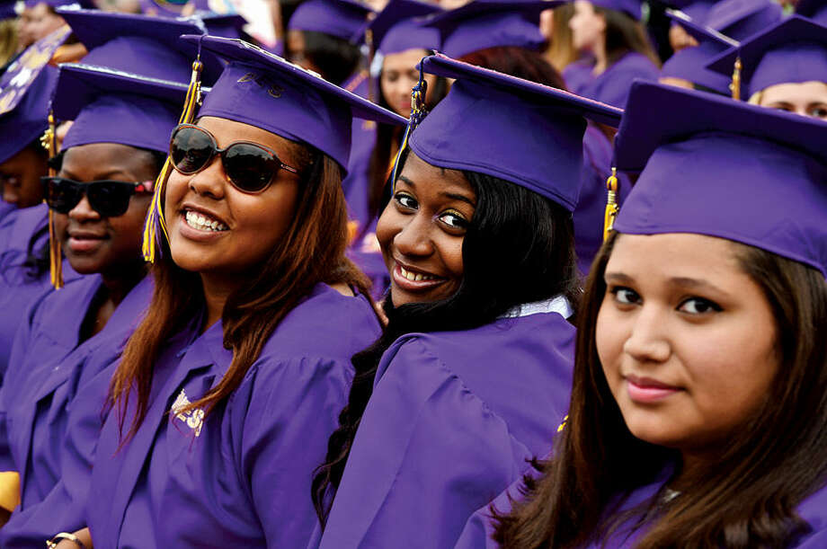 Hour photo / Erik Trautmann Westhill High School seniors celebrate during their commencement ceremonies for the Class of 2015 Thursday.