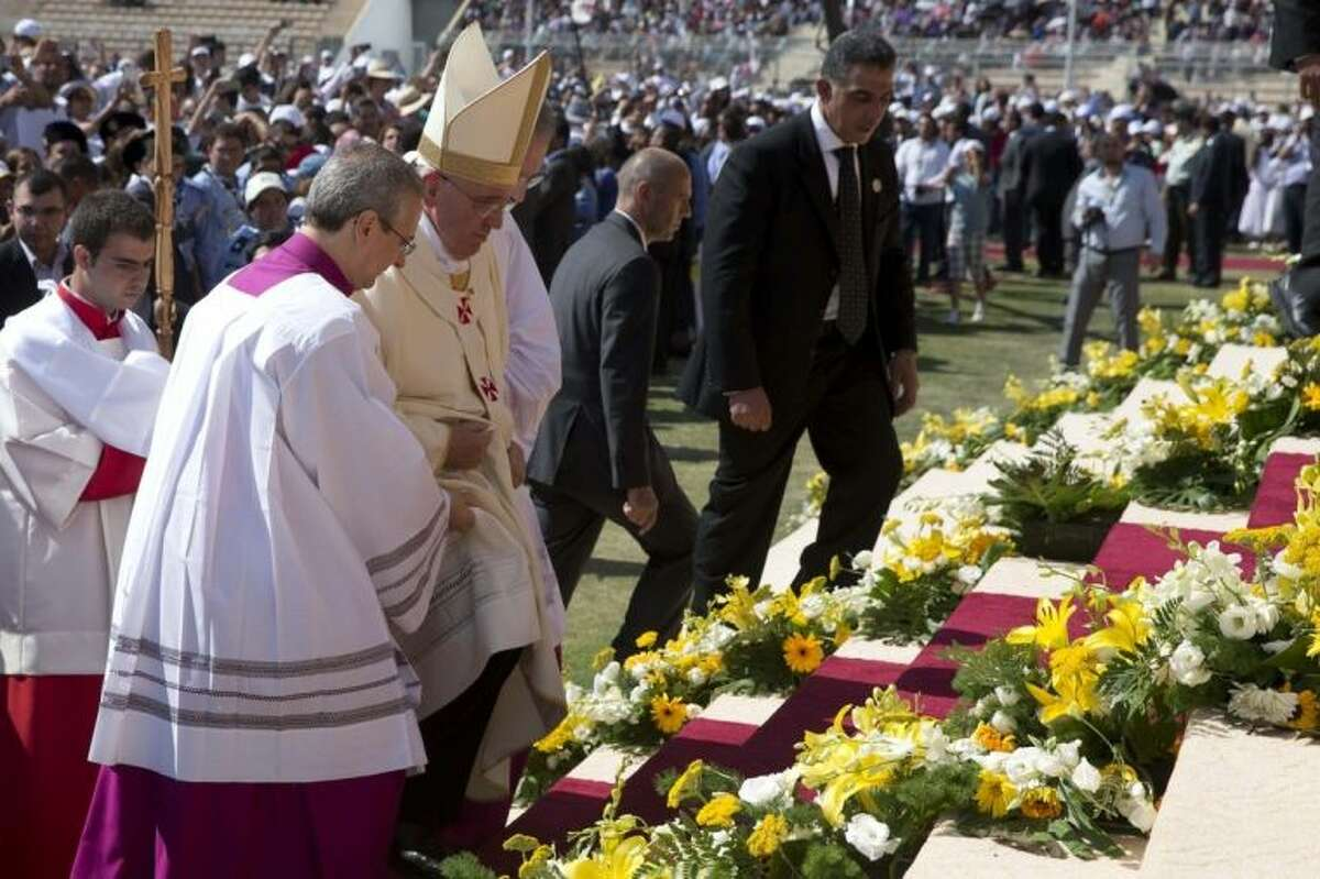 Pope Francis arrives to celebrate a mass in Amman's International Stadium, Jordan, Saturday, May 24, 2014. The pontiff is in Jordan on the first of a three day trip to the Middle East that will also take him to the West Bank and Israel. (AP Photo/Andrew Medichini, Pool)