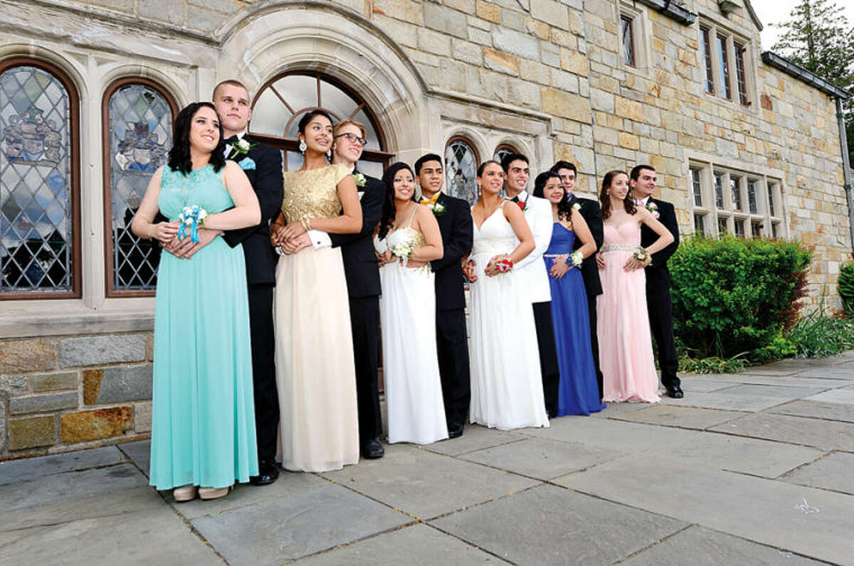 Hour photo / Erik Trautmann Norwalk High School students pose for pictures at Gallaher Mansion Saturday before leaving for the prom.