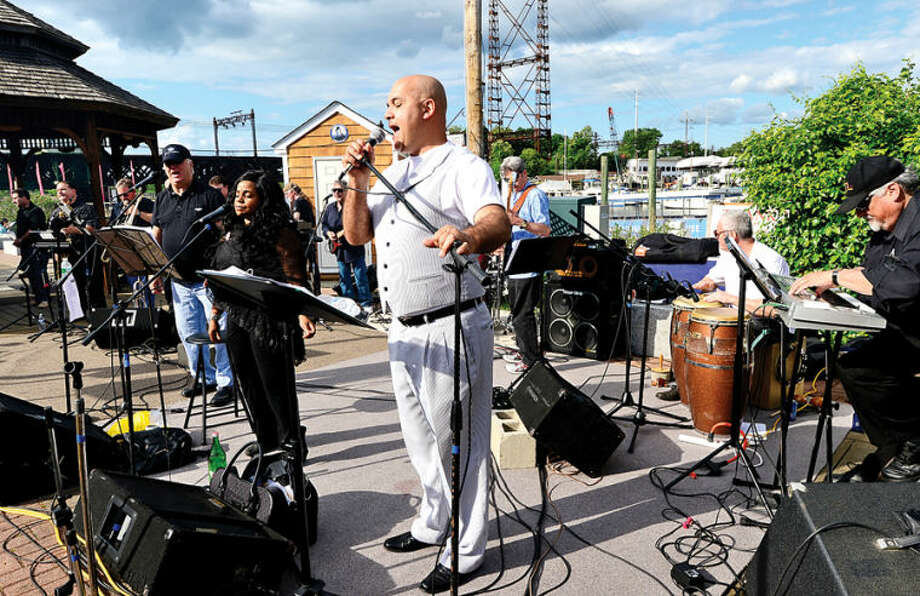 The Tim Currie Band plays at the Norwalk Seaport Association's Commissioning Day reception at the Sheffield Island Ferry dock Saturday,