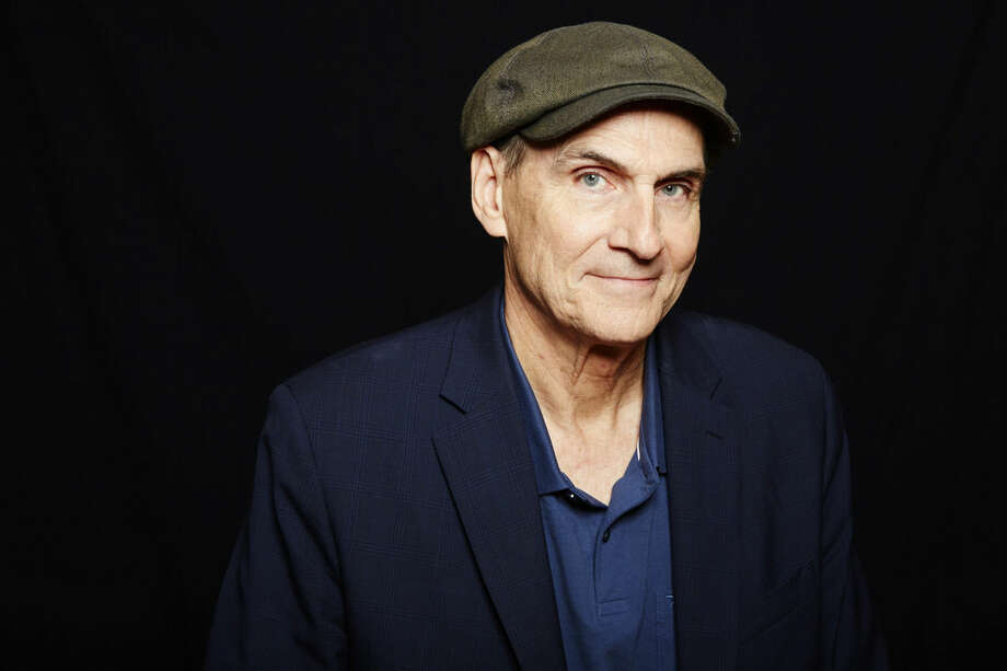 "FILE - In this May 13, 2015 file photo Grammy Award winning singer-songwriter James Taylor poses for a portrait in New York. Taylor released his latest album, ""Before This World,"" this week. (Photo by Dan Hallman/Invision/AP, File)"