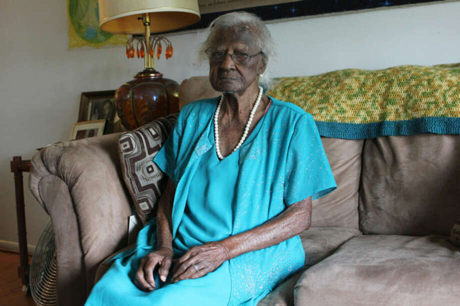 Jeralean Talley, of Inkster, Mich., poses for a photo on Thursday, May 22, 2014. Talley turned 115 on Friday, May 23, 2014, making her the oldest living American and second-oldest person in the world on a list kept by the Gerontology Research Group, which tracks many of the world's oldest people. (AP Photo/Detroit Free Press, Elisha Anderson) DETROIT NEWS OUT; NO SALES