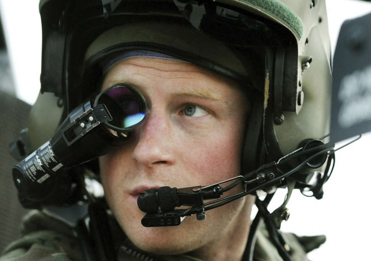 FILE- In this Dec. 12, 2012 file photo, Prince Harry wears his monocle gun sight as he sits in the front seat of his cockpit at the British controlled flight-line, in Camp Bastion , southern Afghanistan. Prince Harry has formally ended his full-time military service in Britain's army, wrapping up a career in which he qualified as an Apache helicopter pilot and completed two tours of duty in Afghanistan. The announcement that Friday, June 19, 2015 was Harry's final day was widely anticipated. The fifth in line to the throne had revealed in March that he intended to end his service to take a more vigorous role in his charitable endeavors. (AP Photo/ John Stillwell, Pool, File)