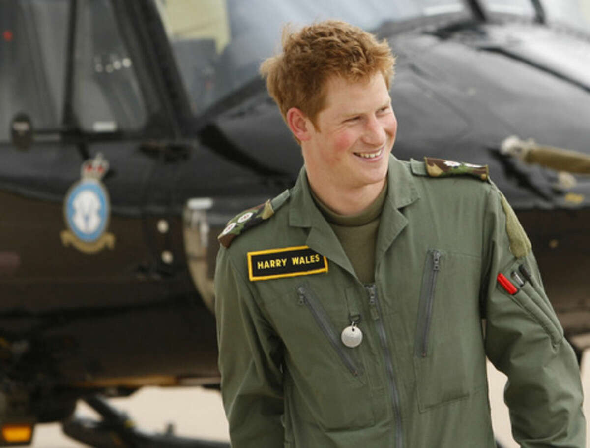 FILE - In this Thursday, June 18, 2009 file photo Britain's Prince Harry smiles during a photo call at RAF (Royal Air Force) Shawbury in Shropshire, England. Prince Harry has formally ended his full-time military service in Britain's army, wrapping up a career in which he qualified as an Apache helicopter pilot and completed two tours of duty in Afghanistan. The announcement that Friday, June 19, 2015 was Harry's final day was widely anticipated. The fifth in line to the throne had revealed in March that he intended to end his service to take a more vigorous role in his charitable endeavors. (AP Photo/Kirsty Wigglesworth, File)