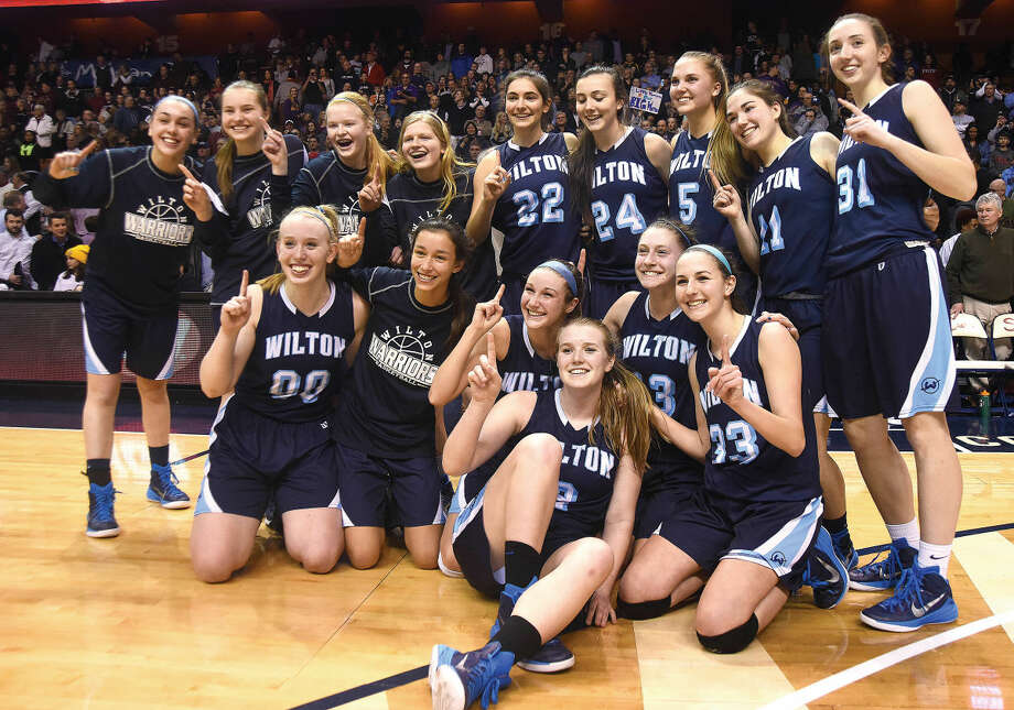 The Wilton Warriors girls basketball team not only won the Class LL state title but they helped change the way people look at girls basketball in Wilton. (Hour photo/John Nash)