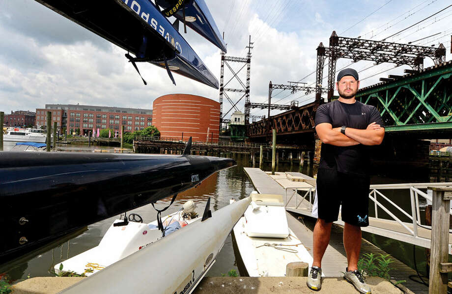 Hour photo / Erik Trautmann Roman Vengerovskiy General Manager of Maritime Rowing Club on Goldstein Place in Norwalk is concerned over the states plans for the replacement of Walk Bridge.